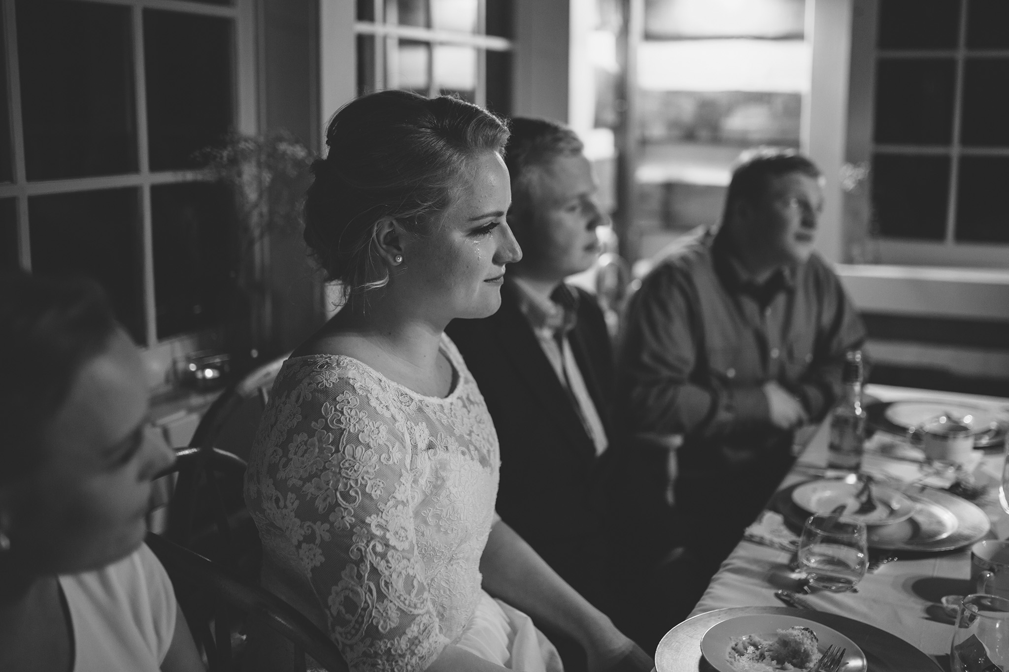 bride listening to a speech with a tear