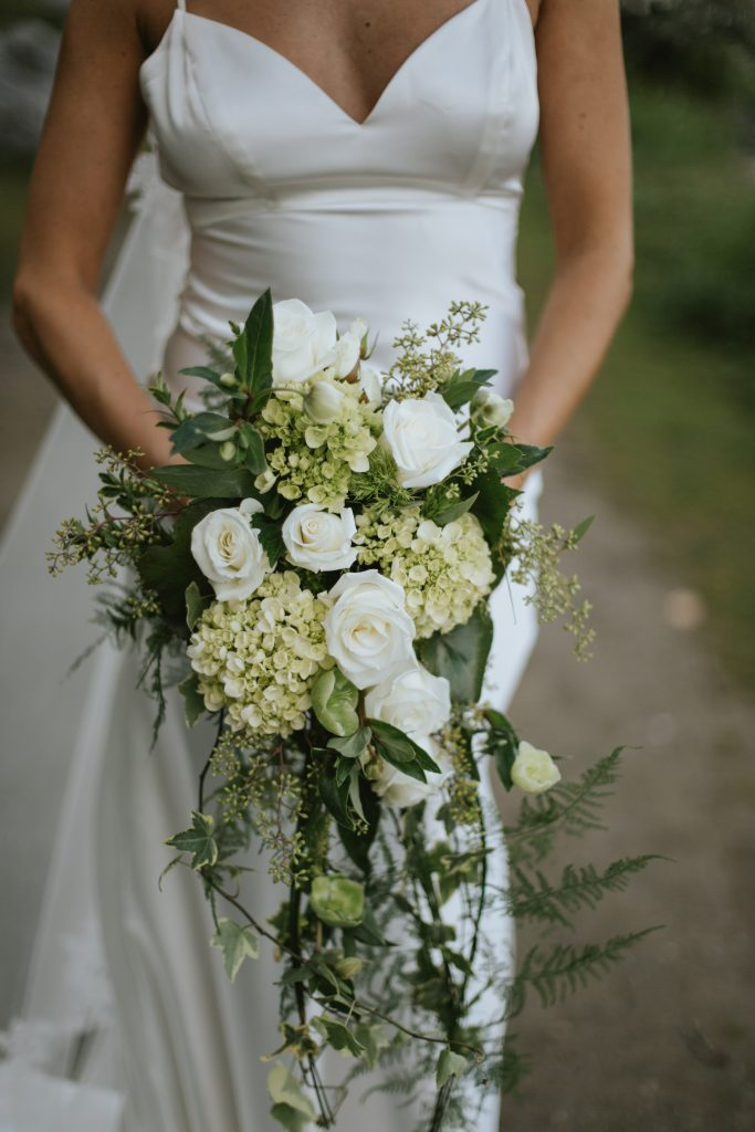 cascading bouquet of greenery and white flowers