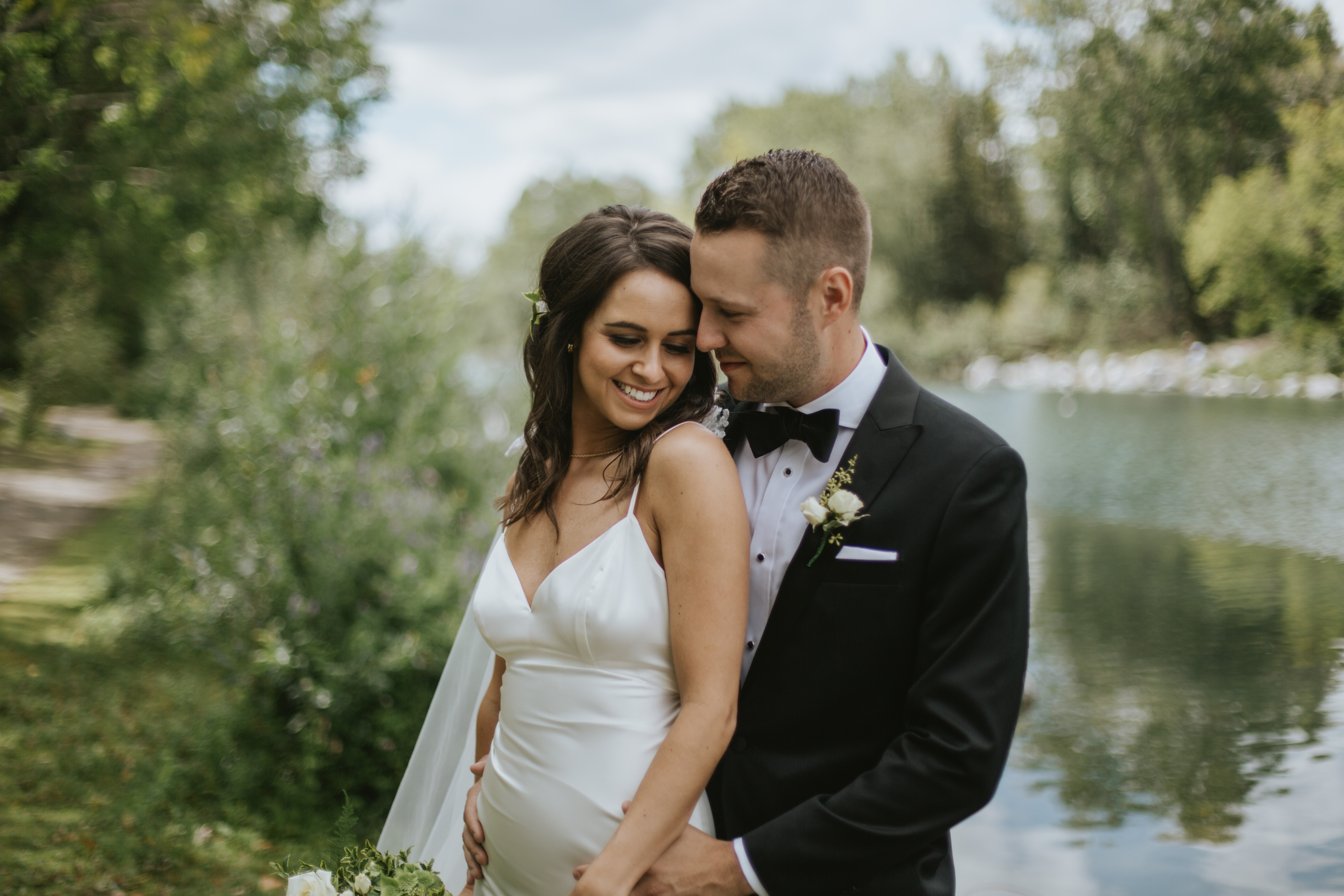bride and groom by the bow river