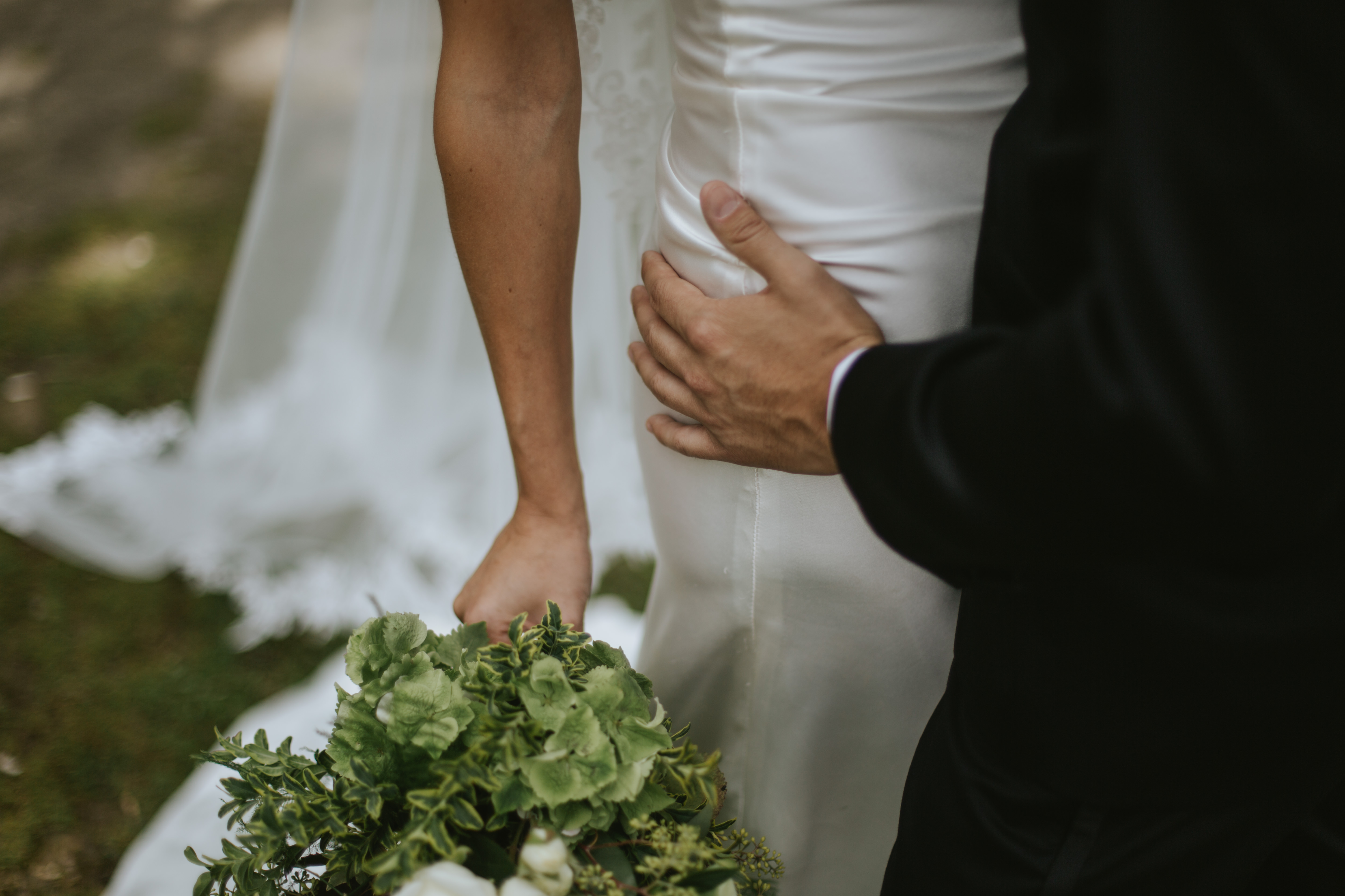 groom touches bride's hip