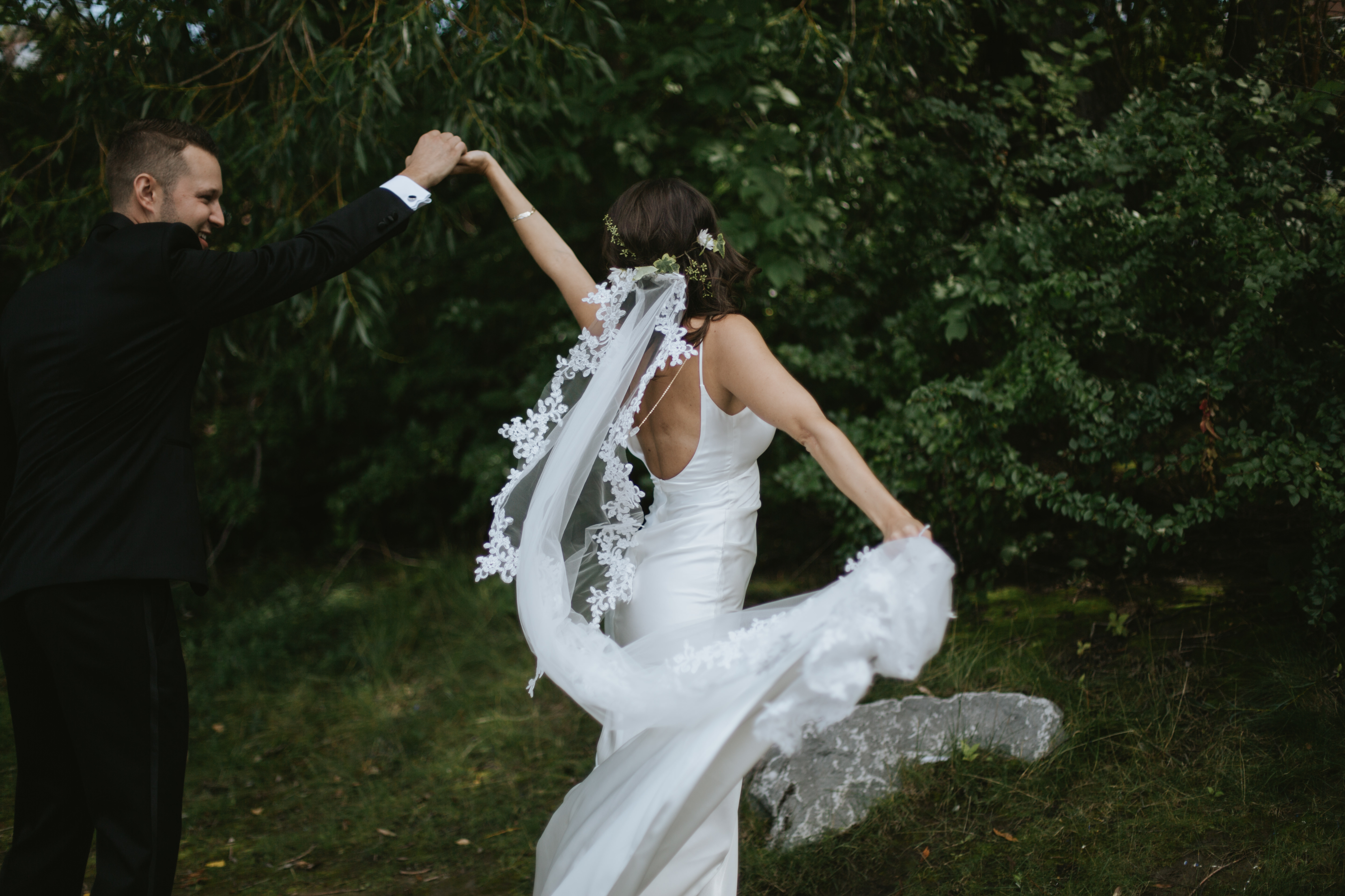 bride and groom dance by the river
