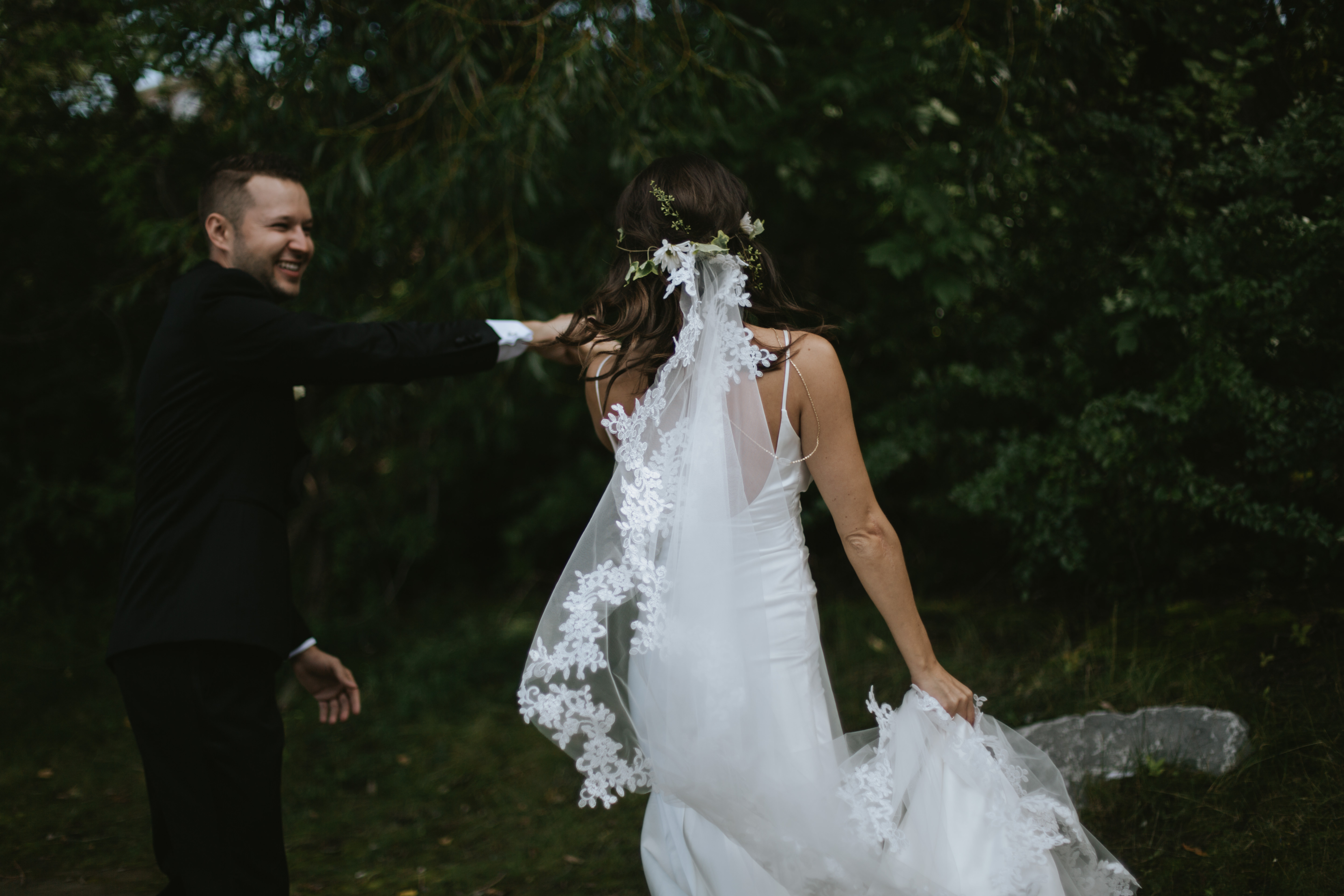 groom swings bride around while she holds her dress up