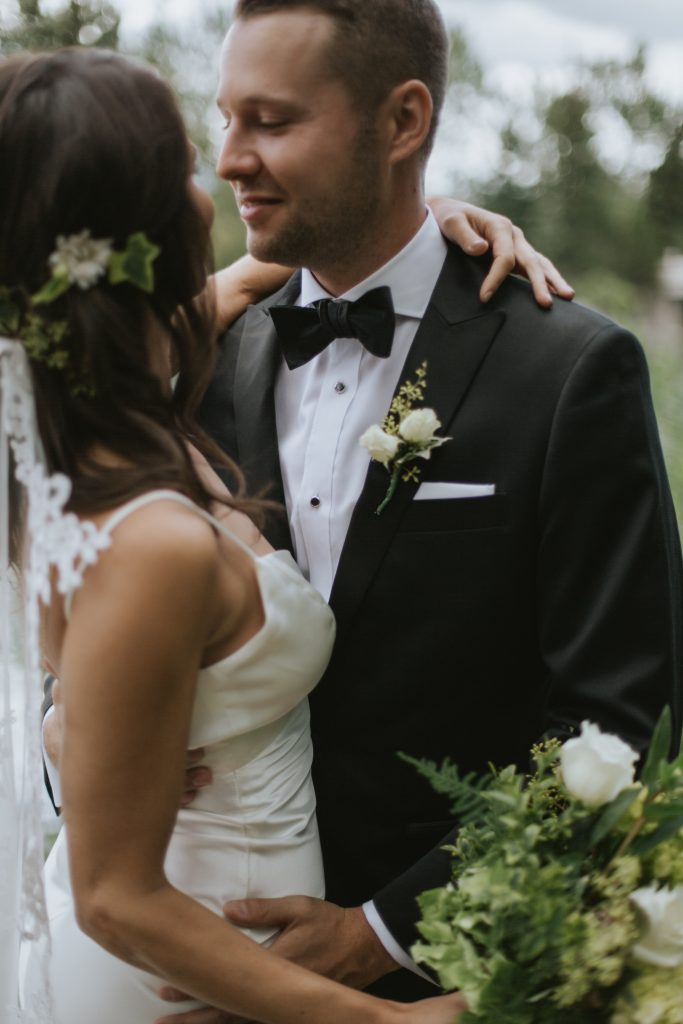 the bride and groom intimately embrace