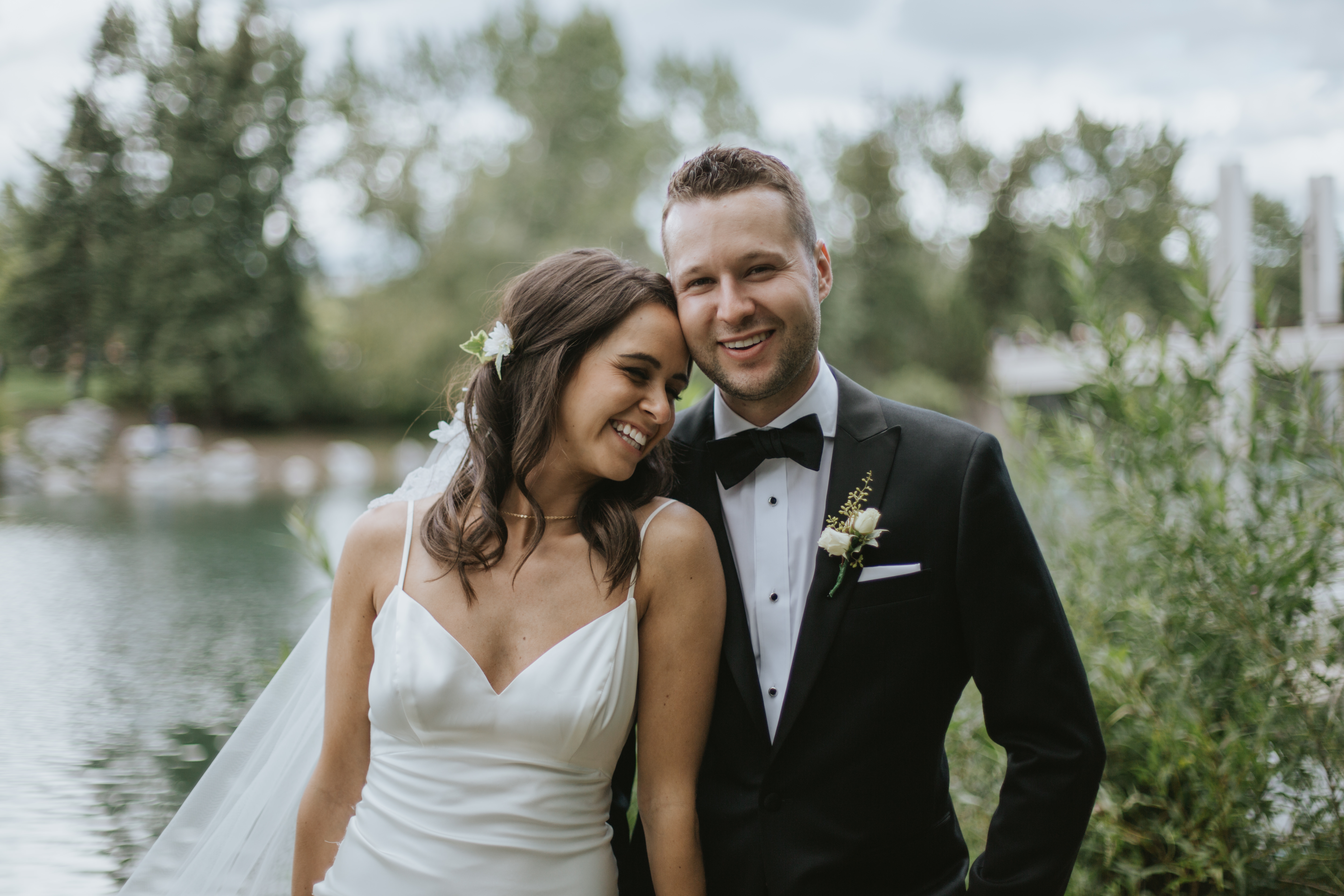 bride and groom laugh at the camera