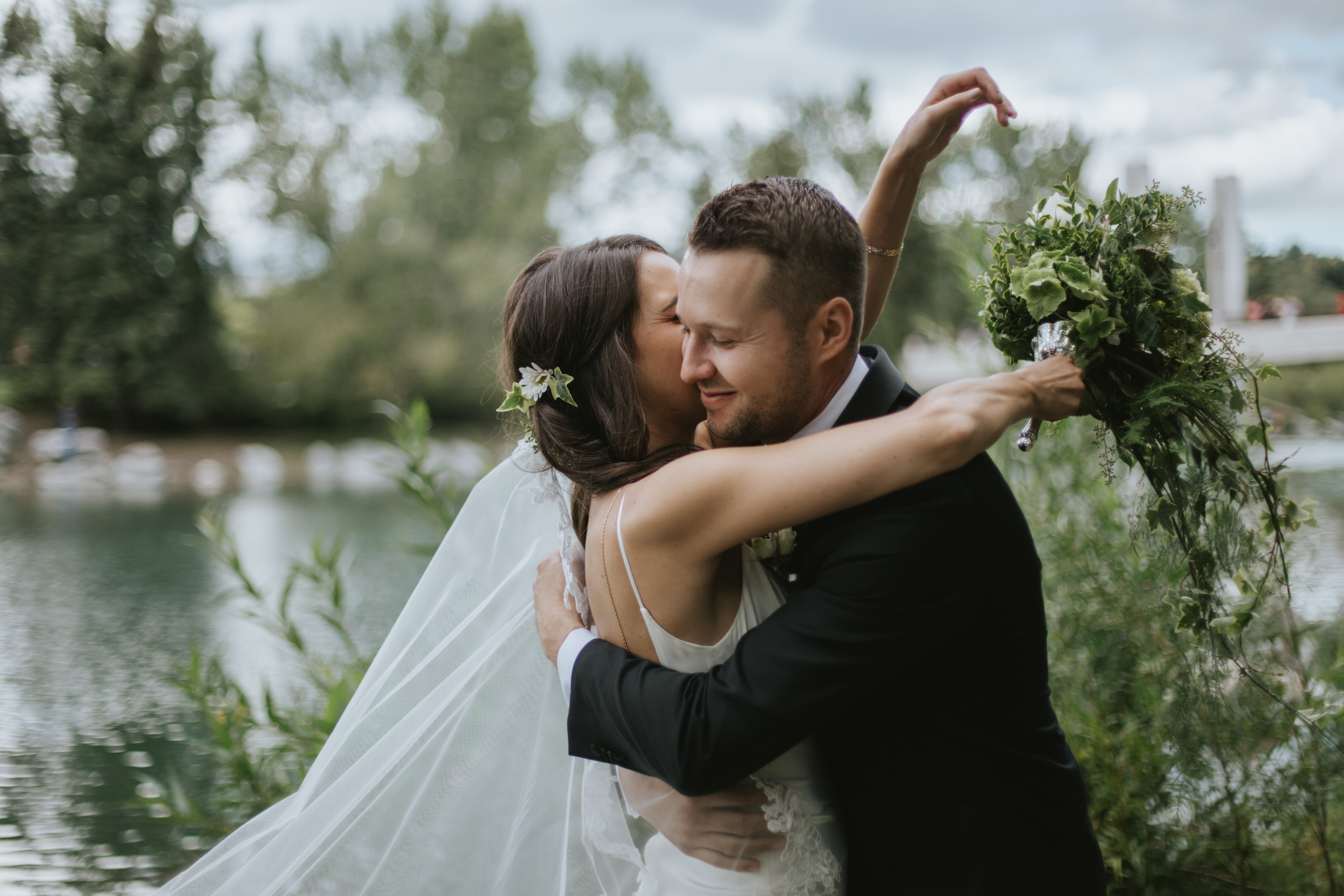 groom pulls the bride in for a hug
