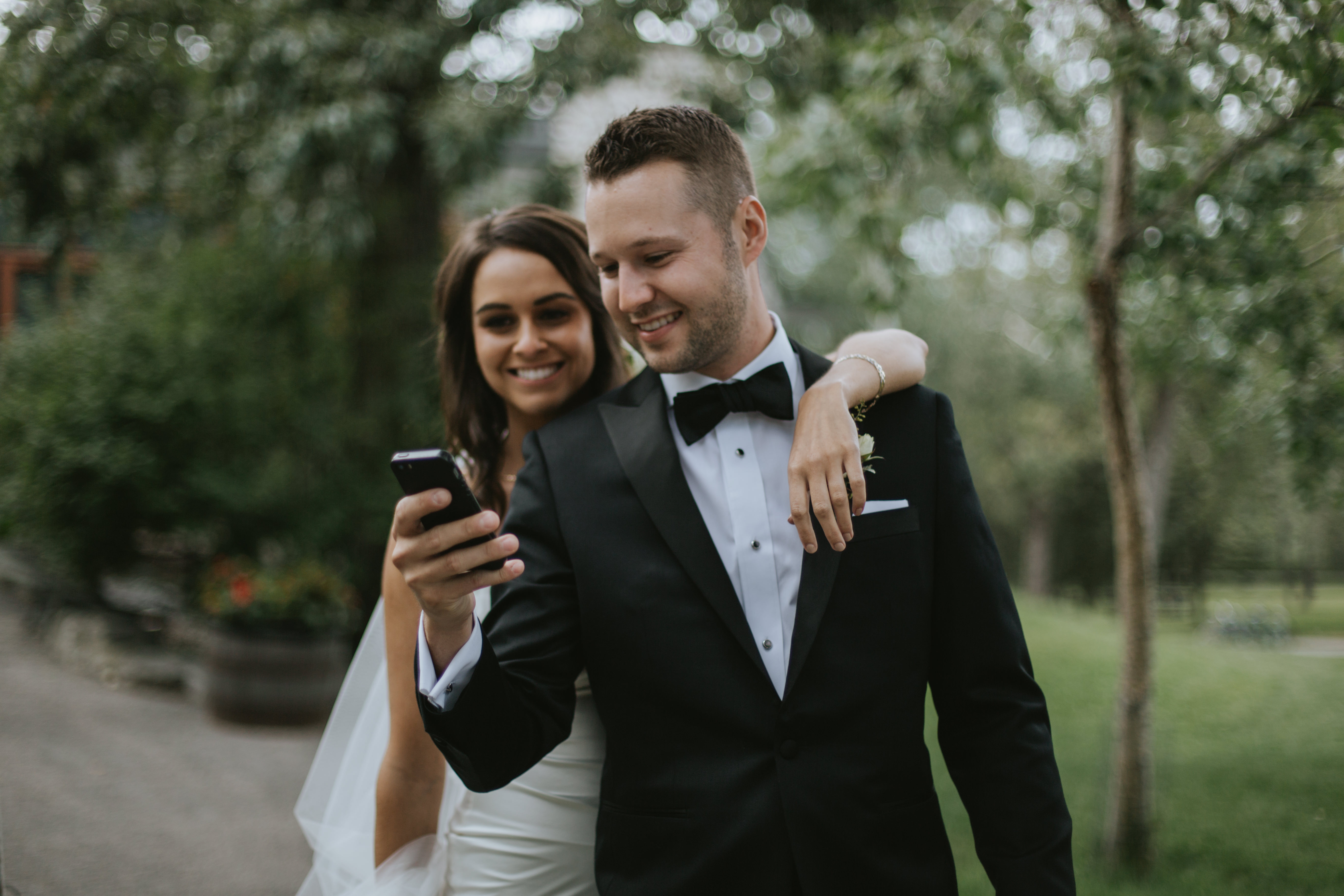 the bride and groom take a selfie