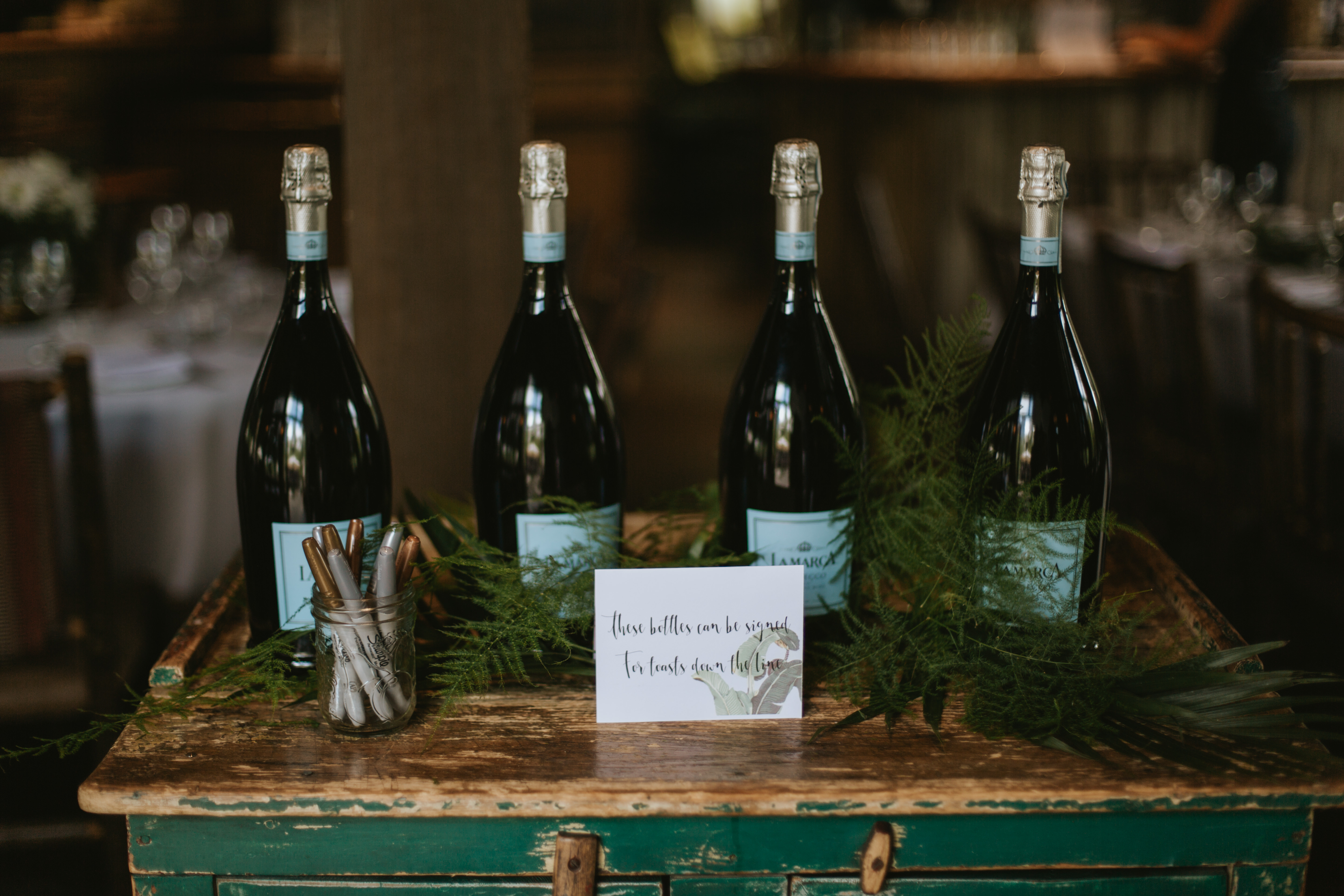 bottles of champagne as the guest book