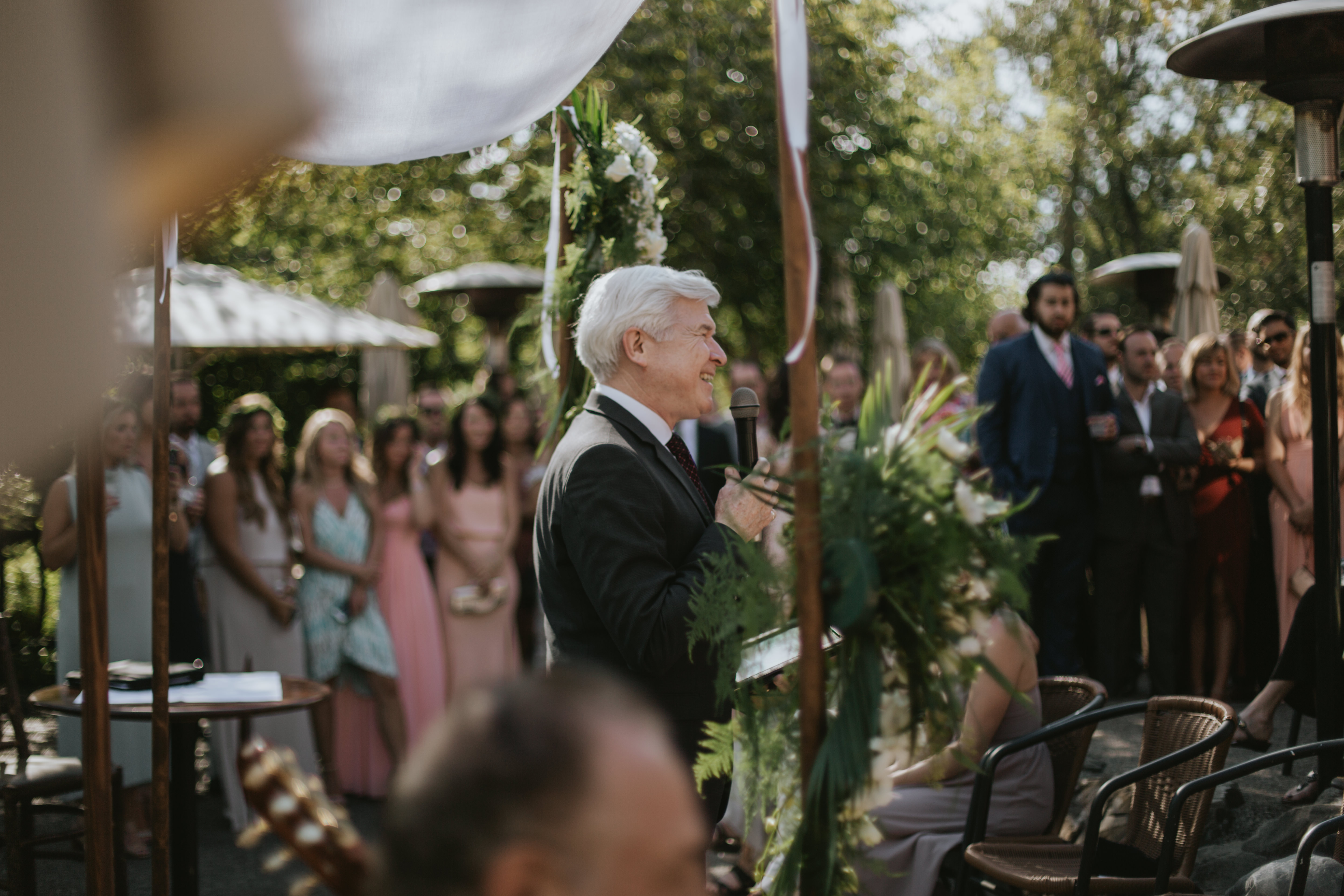 the officiant speaks to the guests