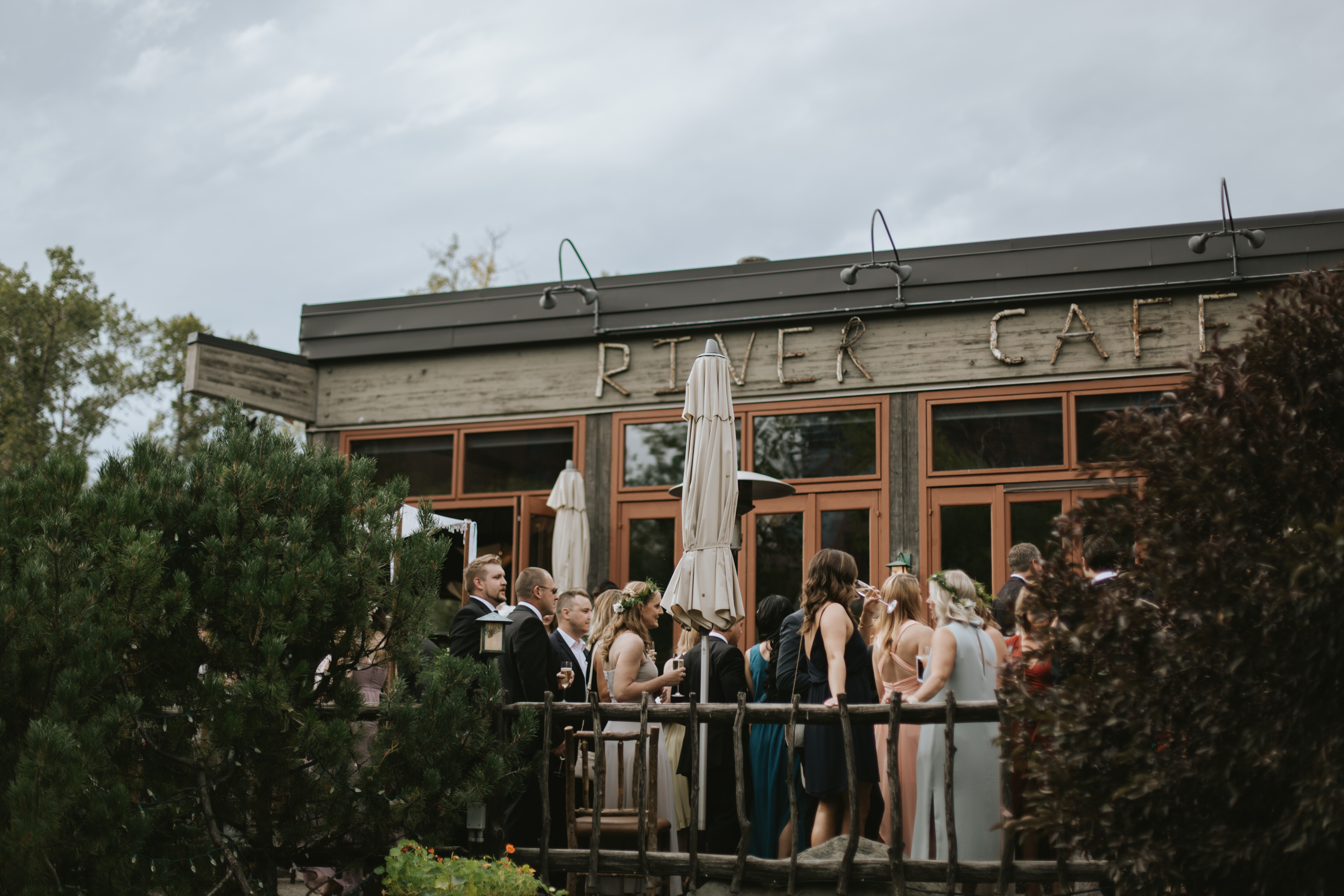 guests mingle on the river cafe patio