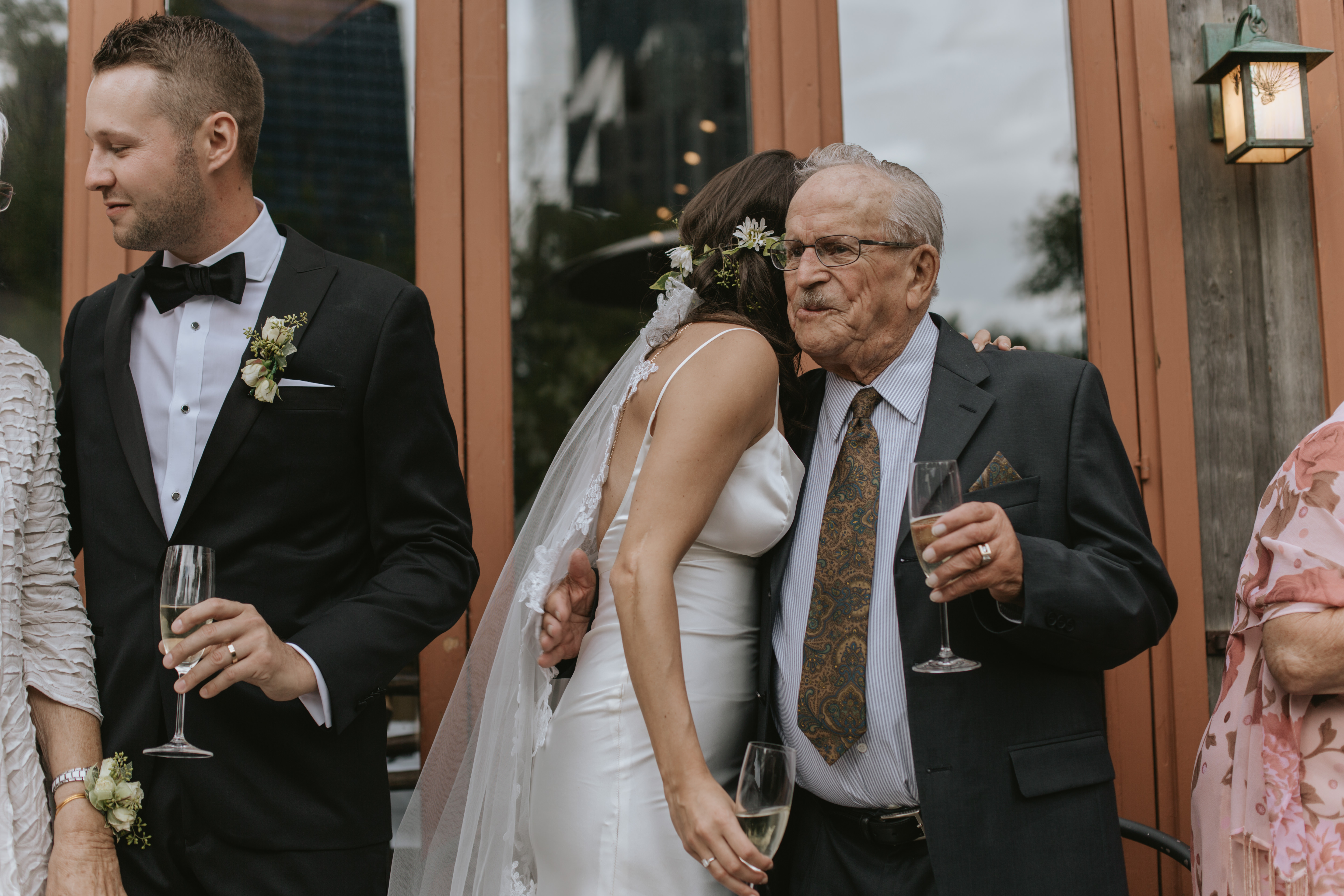 the bride hugs her grandfather