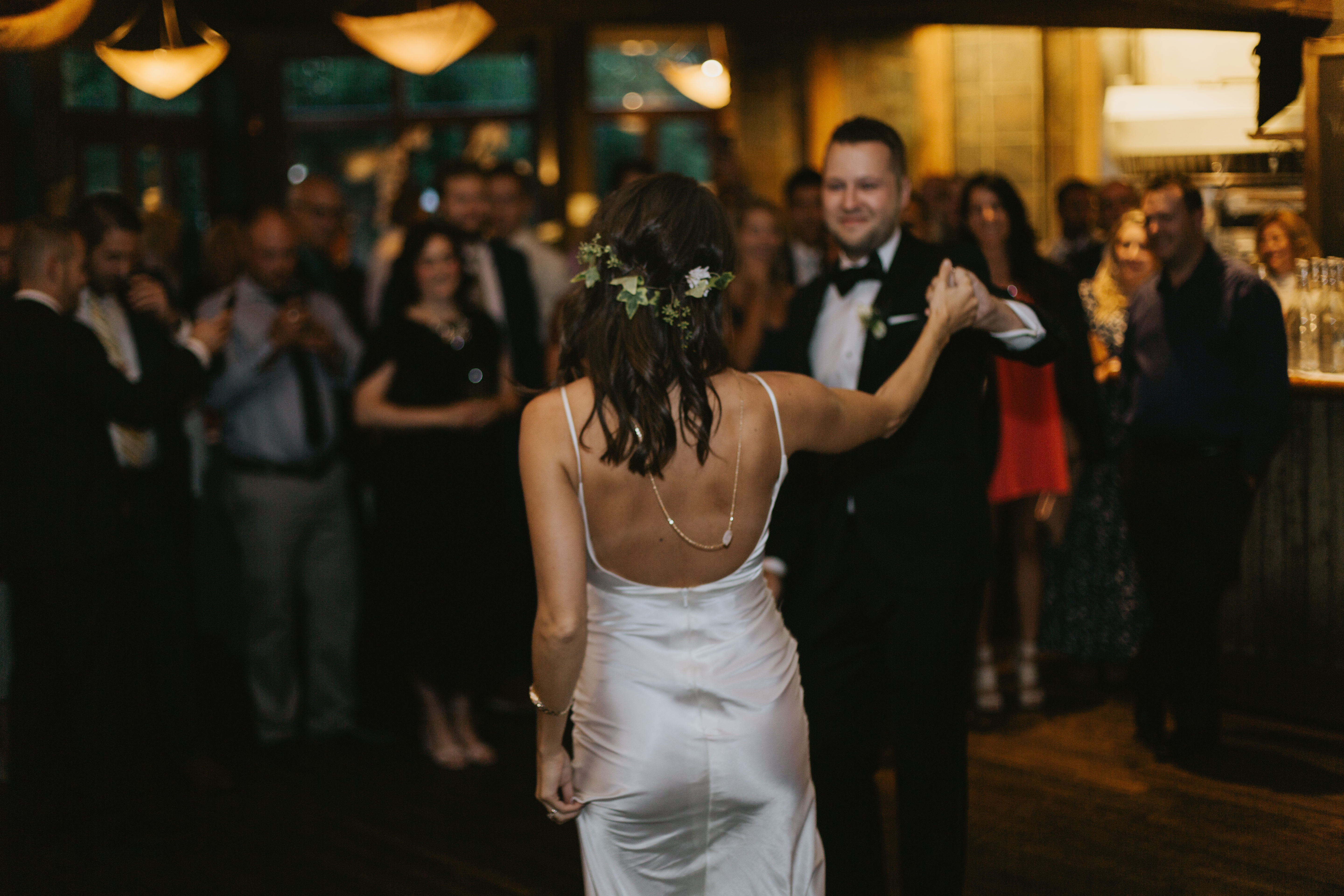 the bride and groom share their first dance
