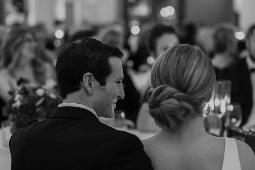 groom looking lovingly at bride