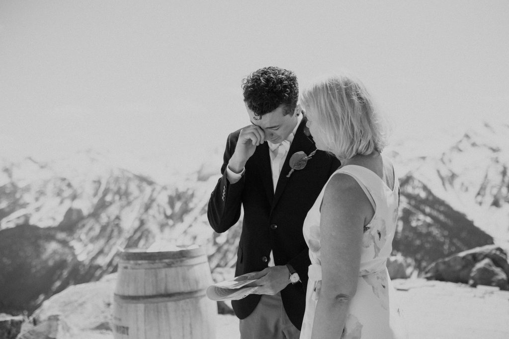 groom cries with mother