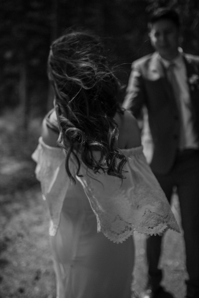 bride and groom dance in the forest